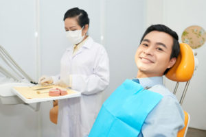 The dentist prepares the materials before proceeding to dental treatment.