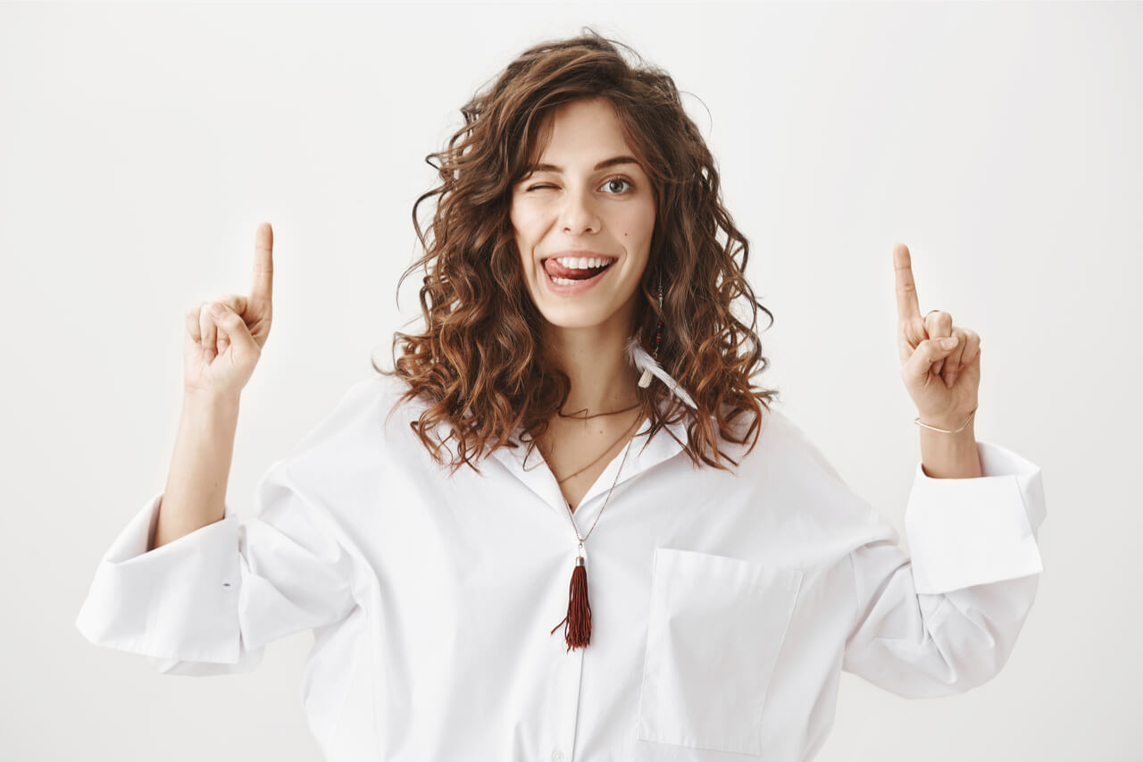 The woman is happy to know the different ways to prevent root canal treatment.